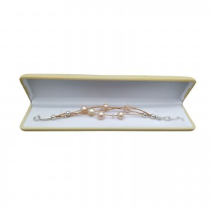 Bracelet with pink round pearls on a thong PB13-C-1