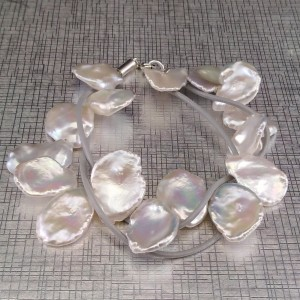 Bracelet made of genuine white keshi pearls on a thong 19 cm PB49-1