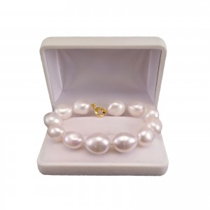 Bracelet made of real pearls of white baroque with a gold-plated clasp PBS39