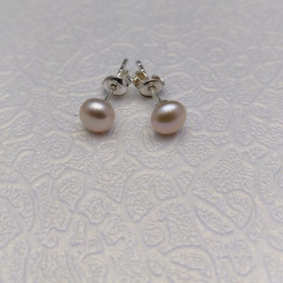 Silver earrings with pink 5-5.5 mm pearls on the stick PK07-C